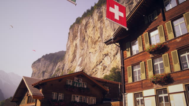 panning shot of paragliders from lauterbrunnen, switzerland - chalet stock videos & royalty-free footage