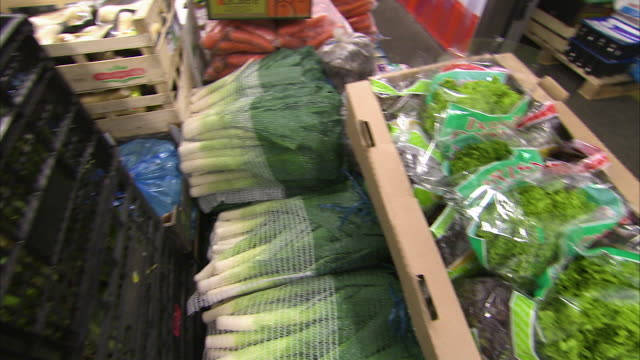 Panning shot of produce delivered to a warehouse