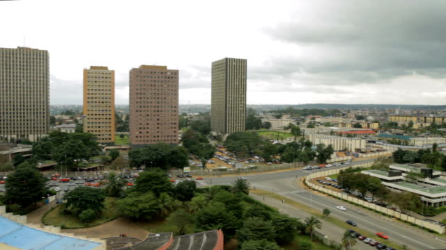 panning shot of roads and high rise buildings/ abidjan/ ivory coast - côte d'ivoire stock videos & royalty-free footage