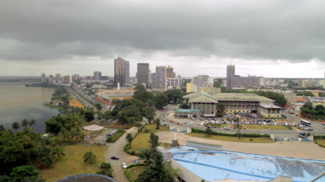 panning shot of roads/ high rise buildings and river/ abidjan/ ivory coast - côte d'ivoire stock videos & royalty-free footage