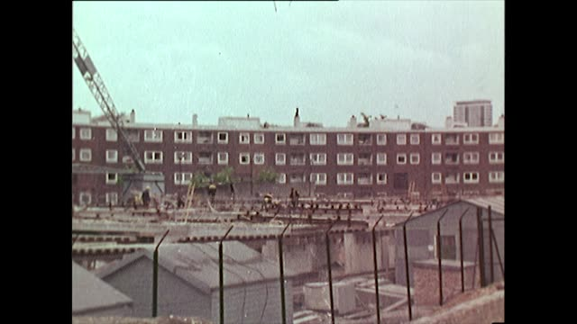 panning shot of run-down and new buildings in liverpool, 1968 - liverpool england stock videos & royalty-free footage