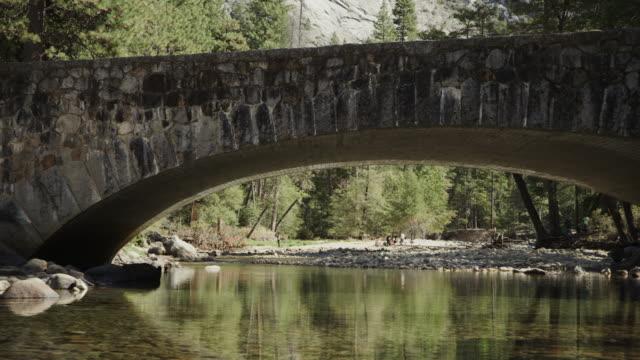 panning shot of scenic view of stoneman bridge over river / yosemite valley, california, united states - yosemite national park stock videos & royalty-free footage