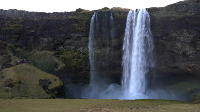panning shot of seljalandsfoss waterfall, iceland - seljalandsfoss waterfall stock videos and b-roll footage