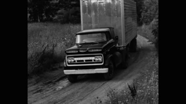 panning shot of semi-truck driving on dirt road - シボレー点の映像素材/bロール