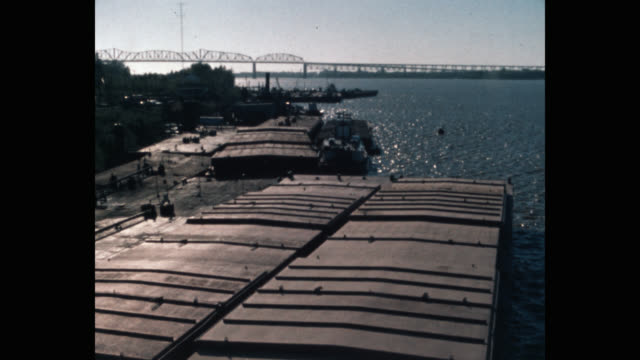 panning shot of ship and barge at harbor, loaded with cargo, on the mississippi in new orleans - new orleans stock videos & royalty-free footage