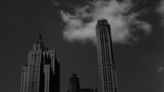 panning shot of silhouetted skyline against sky in lower manhattan, new york city, new york state, usa - 1947 stock videos & royalty-free footage
