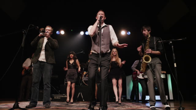 panning shot of singers and musicians performing on stage / spanish fork, utah, united states,  - 2013 stock videos and b-roll footage