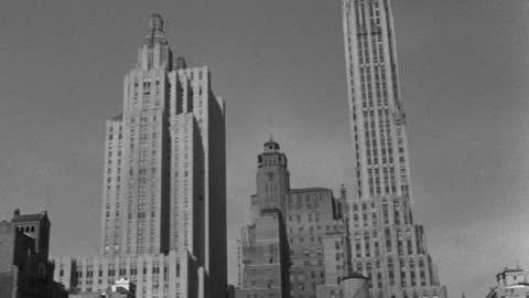 vidéos et rushes de panning shot of skyscrapers against sky in lower manhattan, manhattan, new york city, new york state, usa - 1947