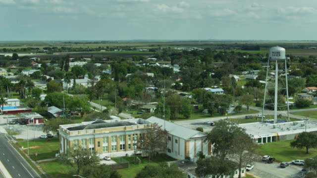 panning shot of small town in central florida - street name sign stock videos & royalty-free footage