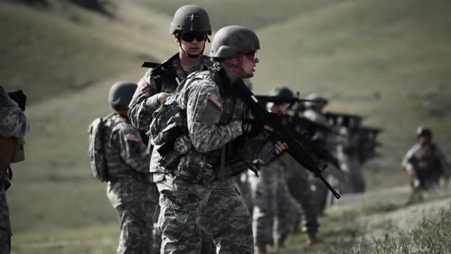 panning shot of soldiers during shooting drill - army stock-videos und b-roll-filmmaterial