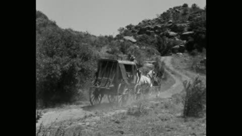 vídeos y material grabado en eventos de stock de panning shot of stagecoach driver riding stagecoach on dirt track - western usa