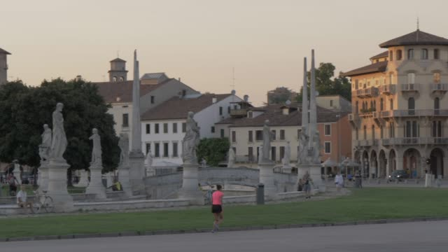 panning shot of statues and architecture in prato della valle at sunset, padua, veneto, italy, europe - prato stock videos and b-roll footage