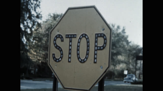 panning shot of stop sign on road - stop sign stock videos & royalty-free footage
