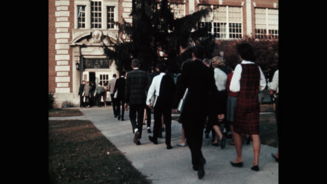 panning shot of students entering high school - education building stock videos & royalty-free footage