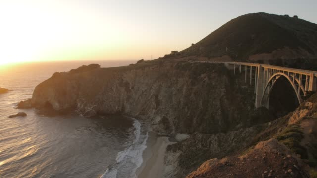 panning shot of sunset from cabrillo highway 1 over bixby creek bridge at big sur, california, united states of america, north america - carmel california stock videos and b-roll footage