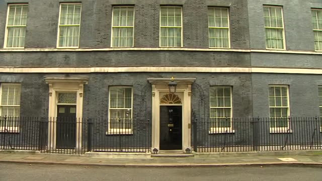 panning shot of the 10 downing street front door - downing street stock videos & royalty-free footage