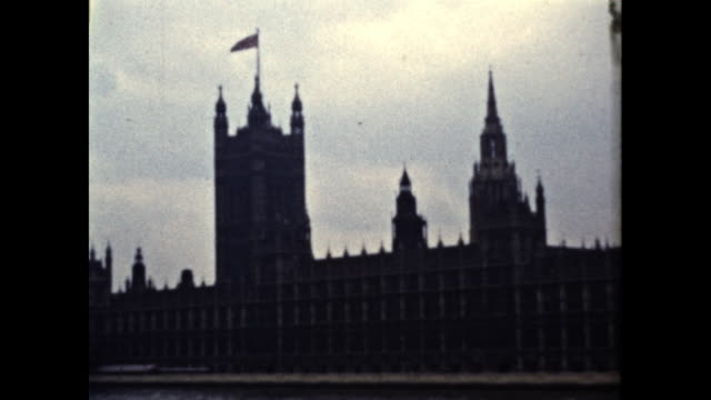 panning shot of the british parliament building on a cloudy day - famous place stock videos & royalty-free footage