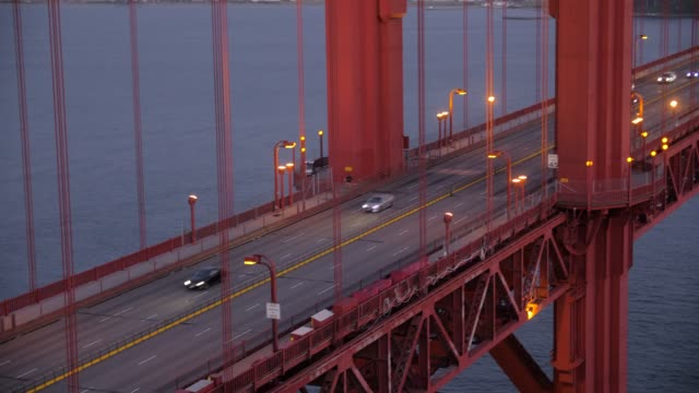 panning shot of the golden gate bridge and busy traffic at dusk, san francisco, california, united states of america, north america - golden gate bridge stock-videos und b-roll-filmmaterial
