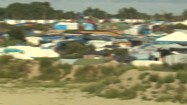Panning shot of the 'Jungle' migrant camp in Calais