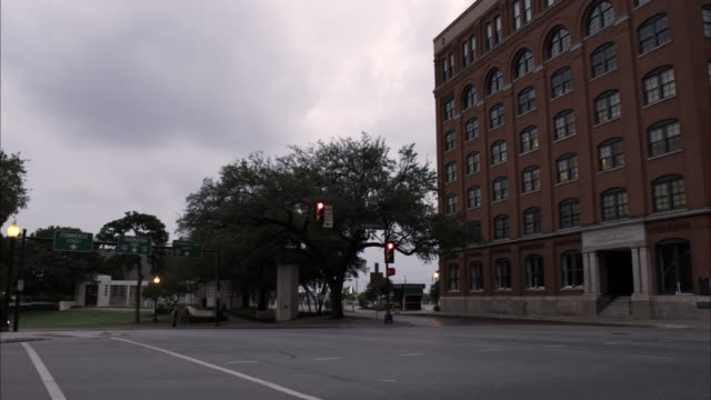 Panning shot of the Texas School Book Depository at Dealey Plaza, Dallas.
