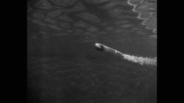panning shot of torpedo passing in atlantic ocean - torpedo stock videos & royalty-free footage