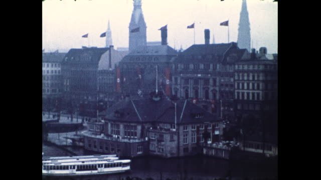 panning shot of town by the water and building covered in nazi swastika flags - nazi swastika stock videos & royalty-free footage