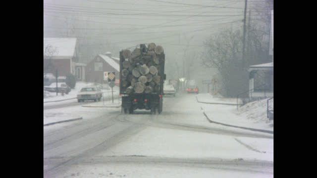 panning shot of truck loaded with logs driving on highway in winter, vermont, usa - forestry industry stock videos & royalty-free footage