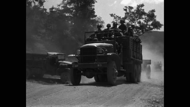 panning shot of us soldiers driving military jeep on country road - less than 10 seconds stock videos & royalty-free footage