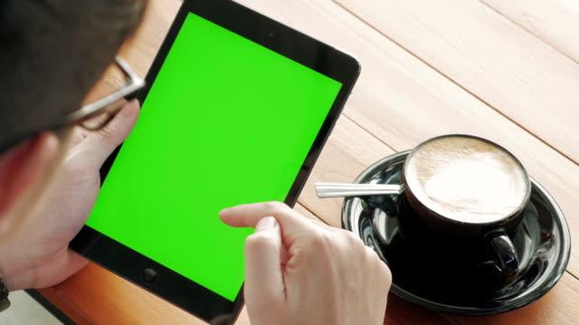 Panning shot of Using digital tablet,Green screen