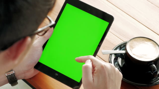 panning shot of using digital tablet,green screen - froth art stock videos and b-roll footage