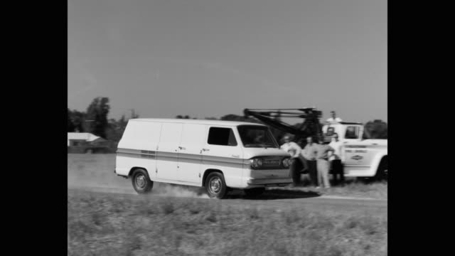 panning shot of van driving on country road, breaking hard and stopping - on the move stock videos & royalty-free footage