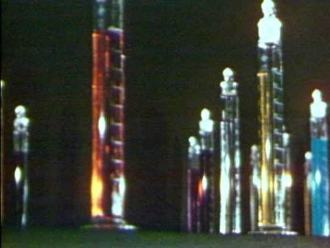 a panning shot of various types of liquid in testtubes - vetreria da laboratorio video stock e b–roll