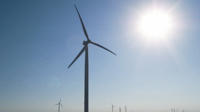 Panning shot of wind turbines