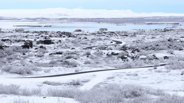 Panning shot of Winter landscape at Dimmuborgir Lake Myvatn, Iceland