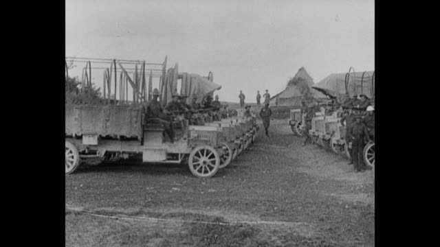 panning shot of wwi army soldiers with off-road vehicles on landscape - world war one stock videos & royalty-free footage
