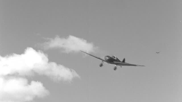 panning shot of zero model fighter planes swoop around each other in world war ii dog fight - air force stock videos & royalty-free footage