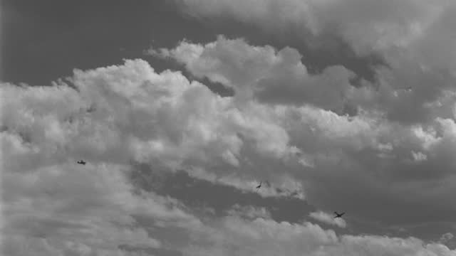 panning shot of zero model fighter planes swoop around each other in world war ii dog fight - 1942 stock videos & royalty-free footage