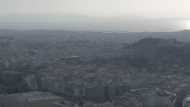 panning shot over athens toward acropolis from mount lycabettus, athens, greece, europe - lycabettus hill stock videos & royalty-free footage