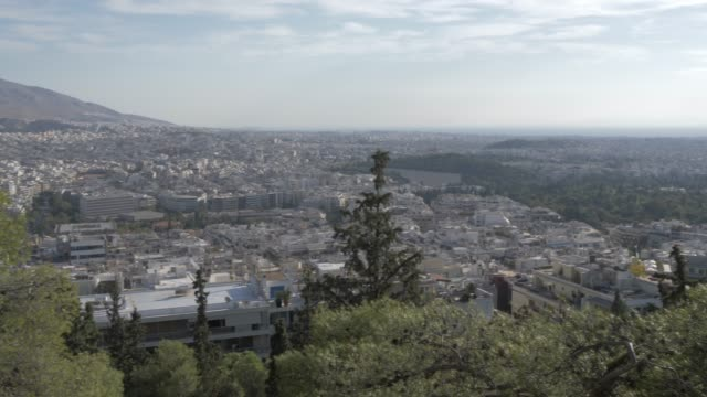 panning shot over athens toward the acropolis from mount lycabettus, athens, greece, europe - lycabettus hill stock videos & royalty-free footage