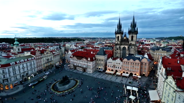 panning shot: pedestrian crowded at old town square prague czech republic sunset - stare mesto stock videos & royalty-free footage