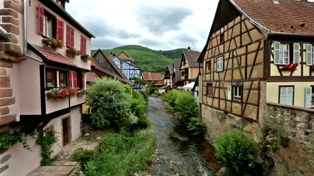 panning shot: pedestrian crowded kaysersberg village cityscape alsace france - urban road stock videos & royalty-free footage