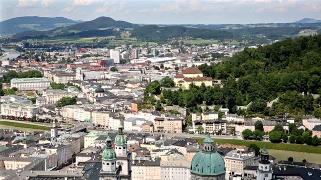panning shot: Pedestrian crowded Salzburg Cityscape city square Austria