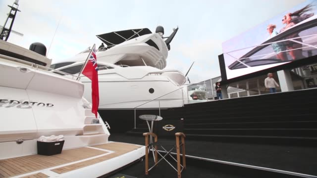 panning shot people look at the various types of boats for sale on the opening day of the annual psp southampton boat show on september 13 2013 in... - world water day stock videos and b-roll footage