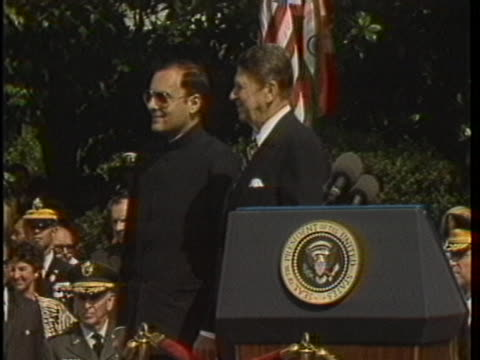 panning shot president ronald reagan and first lady nancy reagan greets indian prime minister rajiv gandhi as he steps out of his limo cut to reagan... - united states and (politics or government) stock videos & royalty-free footage