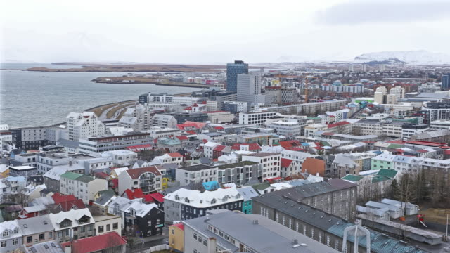 panning shot: rekjavik cityscape from hallgrimskirkja cathedral reykjavik iceland - reykjavik stock videos and b-roll footage
