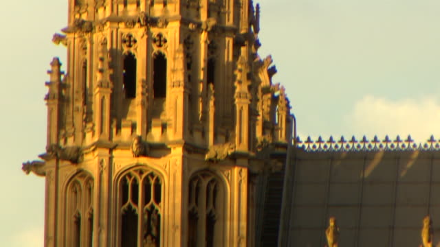 panning shot running down the spire of the central tower at the palace of westminster, london - turmspitze stock-videos und b-roll-filmmaterial