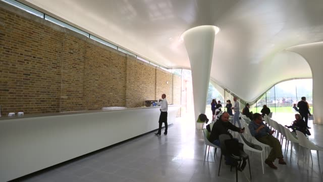vídeos y material grabado en eventos de stock de panning shot, serpentine sackler gallery interior. members of the public admire the redeveloped serpentine sackler gallery in hyde park on september... - jeremy paxman