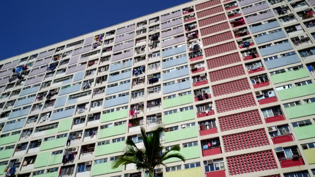 panning shot showing colourful facade at choi hung estate on a clear day, hong kong - block shape stock videos & royalty-free footage