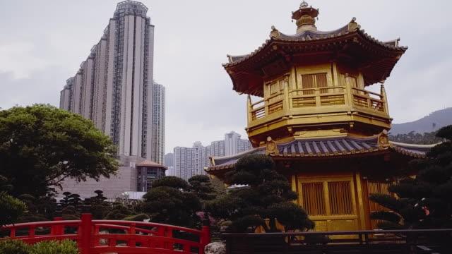 panning shot showing part of the chi lin nunnery, diamond hill, kowloon, hong kong - hong kong stock videos & royalty-free footage
