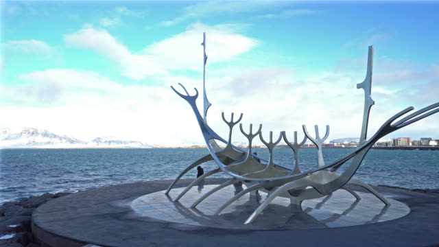 panning shot: solfaris sun voyager statue monument sculpture at reykjavik iceland - reykjavik stock videos and b-roll footage